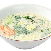 Okroshka (cold soup), served with toasted toasts, greens and mustard